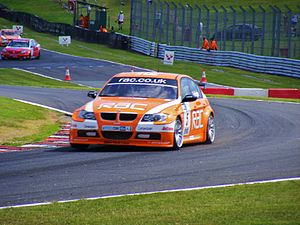 Oulton Park - Colin Turkington goes through Knickerbrook during the BTCC race