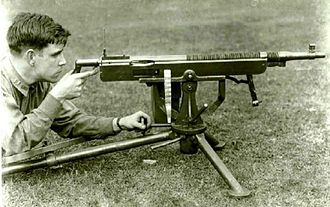 M1895 Colt–Browning machine gun - One of the later versions of the Colt-Browning M1895 machine gun is demonstrated by a US Army operator. The gun is shown mid-action, with the operating lever extending downward below the front of the barrel.