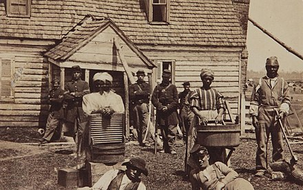 Escaped slaves, ca. 1862, at the headquarters of General Lafayette Contrabands at Headquarters of General Lafayette by Mathew Brady.jpg