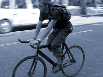 Fixed-gear bicycle - Cyclist riding a fixed gear bike without brakes