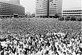 Crowd on City Hall Plaza (9519681996).jpg