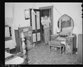 D.B. Henry, miner, entering front door of his four room house, rental $10 monthly. He has made minor repairs, painted... - NARA - 540736.tif