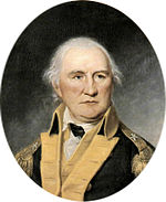 Portrait shows a determined-looking white-haired man in a dark blue military coat with buff lapels.