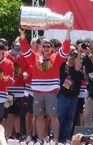 Daniel Carcillo - Carcillo hoists the Stanley Cup at the Grant Park rally celebrating the Chicago Blackhawks' 2013 victory