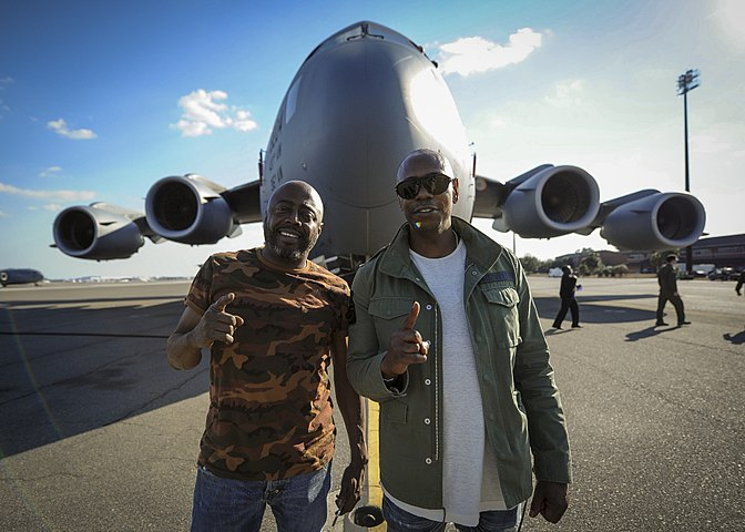 Dave Chappelle and Donnell Rawlings stand in front of a C-17 Globemaster III (32666816002).jpg