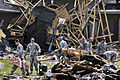Defense.gov News Photo 110421-A-NR754-007 - About 50 U.S. Army soldiers volunteer to help clean up a neighborhood that had been hit by tornadoes in Fayetteville N.C. on April 21 2011. More.jpg