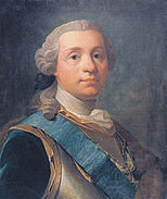 A man in his mid-40s wearing a powdered 18th-century style wig. He has a calm composure and is looking directly at the viewer. He is wearing a cuirass (body armor) adorned with a blue silk band with a dark blue coat underneath. Around his neck hangs an order or medal in the form of a Maltese cross with a royal crown over it, attached to a blue and yellow ribbon.