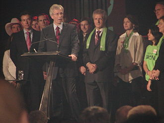 Liberal Party of Canada leadership election, 2006 - Stéphane Dion, making his acceptance speech after winning the party leadership. Visible behind him are Scott Brison, Joe Volpe, Martha Hall Findlay, and Ken Dryden.
