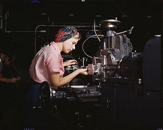 Douglas Aircraft Company - Machine tool operator at the Douglas Aircraft plant, Long Beach, California in World War II. After losing thousands of workers to military service, American manufacturers hired women for production positions, to the point where the typical aircraft plant's workforce was 40% female.