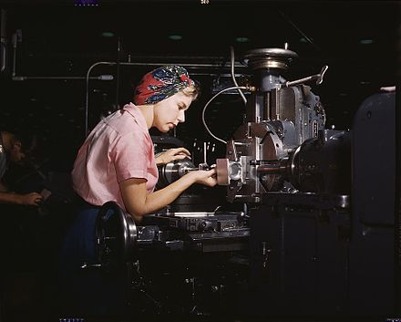 Machine tool operator at the Douglas Aircraft plant, Long Beach, California in World War II. After losing thousands of workers to military service, American manufacturers hired women for production positions, to the point where the typical aircraft plant's workforce was 40% female. Douglas Long Beach.jpg