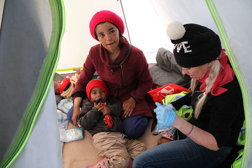 Dr. Alison Thompson with Idomeni refugees.jpg