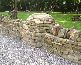 Stone sculpture - Boundary wall featuring a dry stone sculpture, in the Forest of Dean, Gloucestershire, UK