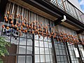 Drying persimmons, Takayama old town (31744396008).jpg