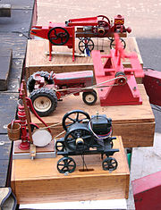 Early internal-combustion engines were used to power farm equipment similar to these models.
