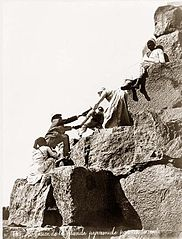 Egypt Great Pyramide tourist ascending 1875.jpg