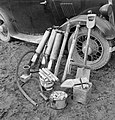 Equipment used by members of the Women's Land Army to deal with rats, including poisons, pumps used to dispense this poison, a shovel and bait, 1942. D11214.jpg