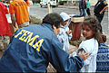 FEMA - 34427 - FEMA community relations worker helping a young resident in New Jersey.jpg