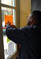 FEMA - 34857 - FEMA Community Relations worker hangs a recovery flyer in Georgia.jpg