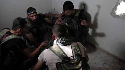 FSA fighters plan during the Battle of Aleppo (October 2012). FSA rebels hold a planning session.jpg