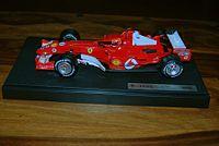 Die cast model of a 1:18 Formula 1 car. This is a Ferrari F2005 model driven by Michael Schumacher in the 2005 season