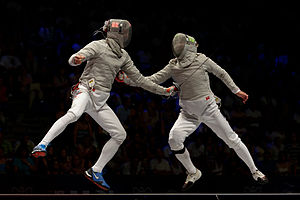 Sabre (fencing) - Veniamin Reshetnikov (L) and Nikolay Kovalev (R) hit each other simultaneously: both lights on the masks are on. Final of the 2013 World Fencing Championships.