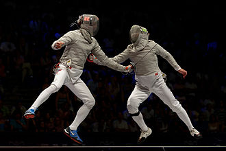 Sabre (fencing) - Veniamin Reshetnikov (Left) and Nikolay Kovalev (Right) hit each other simultaneously: both lights on the masks are on. Final of the 2013 World Fencing Championships.