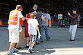 First responders lead simulated victims to medical stations set up in a hangar during the National Disaster Medical System (NDMS) exercise Golden Eagle III at Stewart Air National Guard Base in Newburgh, N.Y 130601-Z-GJ424-046.jpg