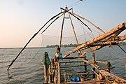 Fishermen on Chinese Fishing Nets Cochin India