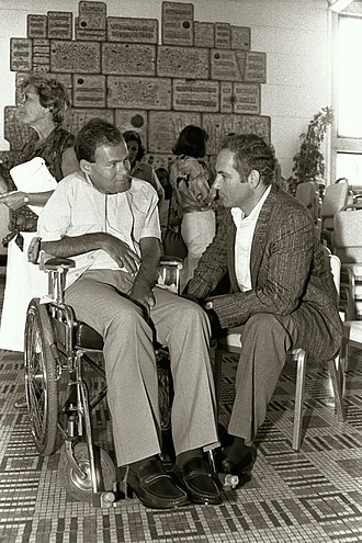 Benjamin Netanyahu - Netanyahu (right) with Sorin Hershko, a soldier wounded and permanently paralyzed in Operation Entebbe, 2 July 1986