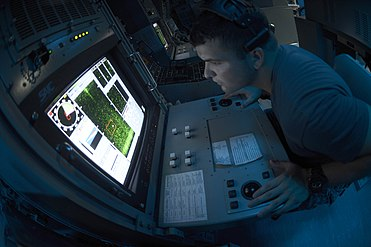 Flickr - Official U.S. Navy Imagery - Sailor looks for mines on sonar..jpg