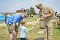 Flickr - Official U.S. Navy Imagery - The CNO extends his challenge coin to a Sailor's son..jpg