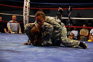 Sgt. Francine Carriaga (top) battles Pfc. Shel...