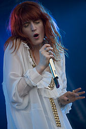Colour photograph of Florence Welch performing live in 2010.