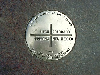 Quadripoint - The boundary marker inscribed at the center of the Four Corners Monument, the only state quadripoint in the United States; where Arizona, Utah, Colorado, and New Mexico meet