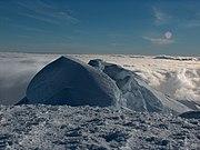 Snow cornices on a ridge top