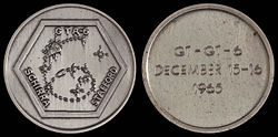Gemini 6 mission emblem and crew names (front). Flight dates (back)