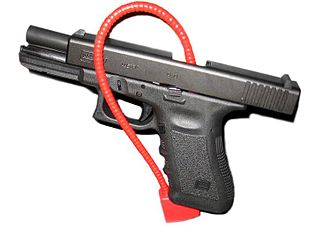 Gun safety - A Glock secured for transport (or storage) with a cable lock.