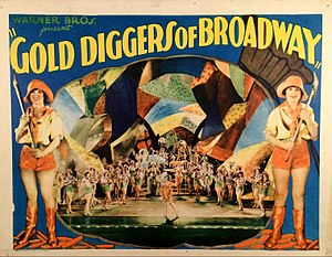 Gold digging - Lobby card for Gold Diggers of Broadway (1929), an example of a film which helped create the American public association of chorus girls with gold diggers.