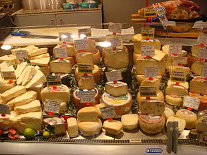 Private good - These cheeses are private goods. They are rivalrous, as the same piece of cheese can only be consumed once. They are also excludable, as it is well possible to prevent someone from consuming the cheese - simply by denying to sell it to them.