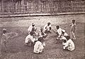 Group of Filipinos holding a cockfight, 1899.jpg