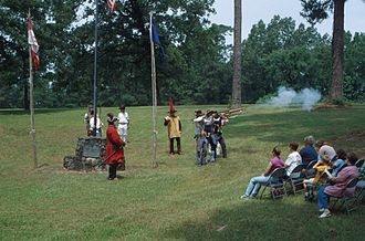 Los Adaes - Reenactors performing a gun salute at the present day historic site