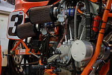 Close-up view of same V-twin racing motorcycle engine from the other, right-hand side