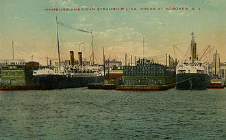 Hamburg America Line - A postcard of the view from the water of the Hamburg-American Steamship Lines docks in Hoboken, New Jersey, in about 1910.
