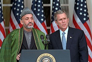 2002 State of the Union Address - Hamid Karzai and George W. Bush addressing reporters at the White House in January 2002, before the State of the Union address.