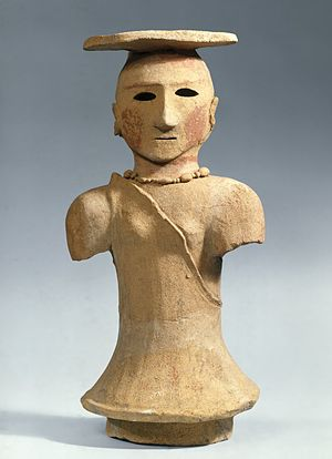Haniwa - Haniwa figure of a shamaness, 5th–6th century. Earthenware. This haniwa represents a Shinto priestess who would have presided over the funeral ceremony of a Yamato chieftain. The figure is fragmentary: the arms are missing and, like almost all extant haniwa, it has been reassembled from shards.