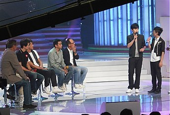 Singers perform on the Chinese variety TV show Happy Camp. Happy Camp (variety show) 8.jpg