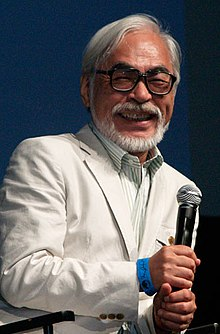 Picture of Miyazaki holding a microphone