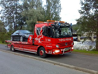 Tow truck Truck used to move disabled, improperly parked, impounded, or otherwise indisposed motor vehicles