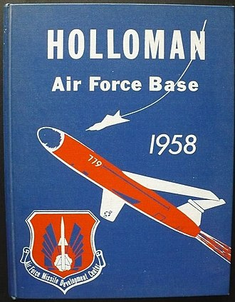 Air Force Missile Development Center - The 1958 cover of the base handbook featured the emblem of the Air Force Missile Development Center