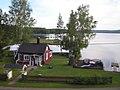 House and lake from passing train - panoramio.jpg